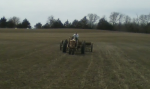 Willard Interseeding on a Massey Ferguson tractor that's not quite as old as he is.